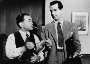 Canny claims adjuster Barton Keys (Edward G. Robinson) relays his suspicions to Neff.