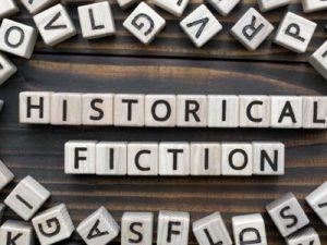 Letter blocks spelling historical fiction